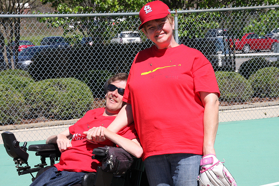 Bertha Maddox of the Cardinals stands next to Matt Cunningham waiting for the next hit their way - Moody Miracle League