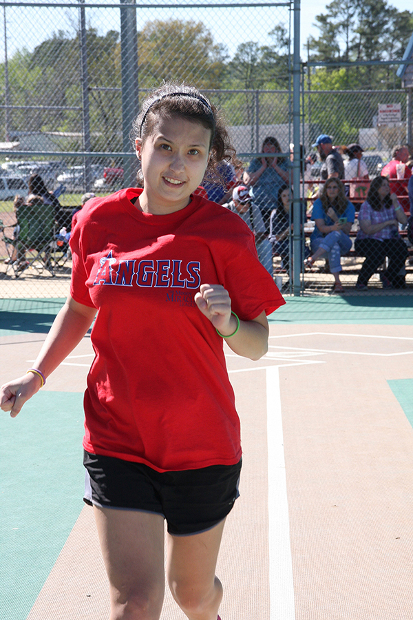 Amanda Katalikstarts down the first base line on another home run trot - Moody Miracle League