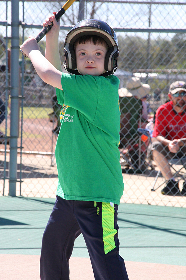 Payton Ray of the Athletics stands ready at the plate looking to hit yet another home run - Moody Miracle League